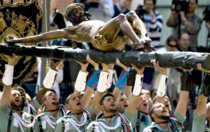 Legionnaires from the third Don Juan de Austria 111 company carry a figure of Christ on a cross during an Easter Holy Week procession in Malaga, Spain, Thursday, April 9, 2009. (AP Photo/EFE, Jorge Zapata) ** NO SALES, LATIN AMERICA, CARIBBEAN AND SPAIN OUT **